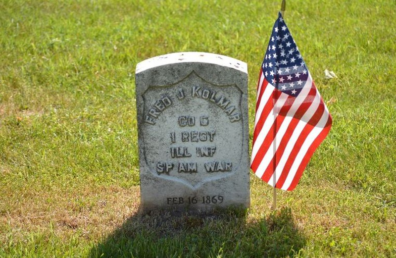 American flag at grave on Memorial Day