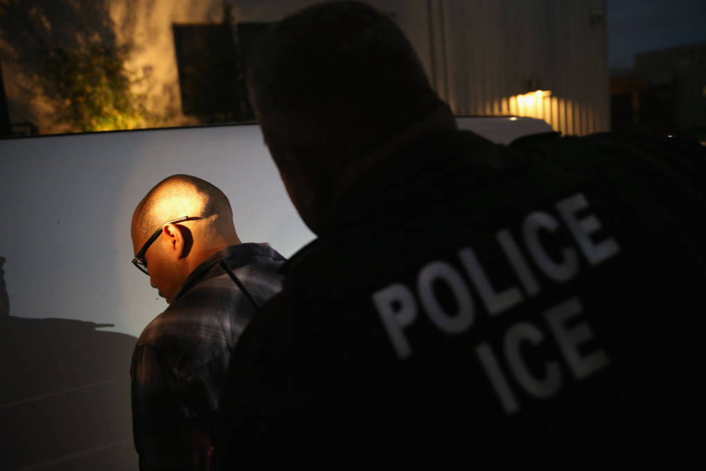 Immigration and Customs Enforcement agents detain a man in Los Angeles in 2015