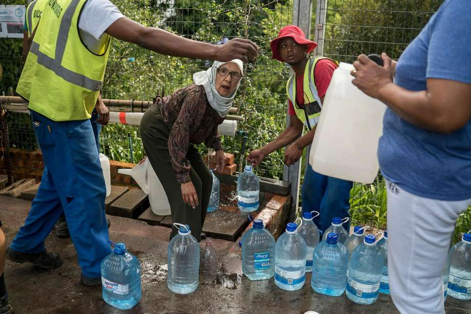 City residents collect water from a spring. A three-year drought is considered the worst in over a century