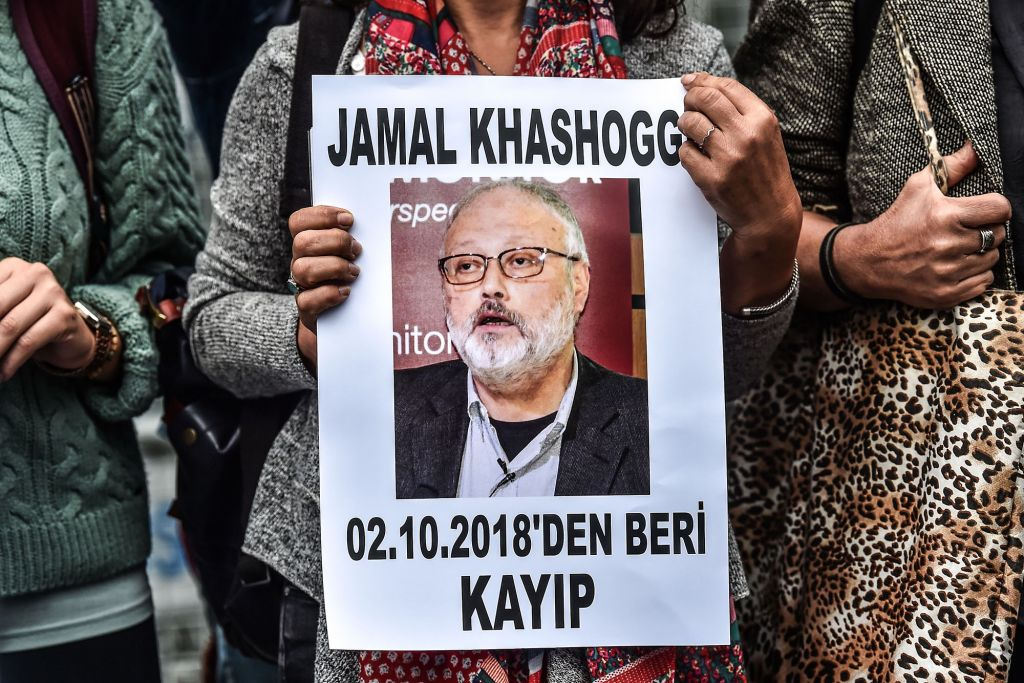A woman holds a portrait of missing journalist and Riyadh critic Jamal Khashoggi
