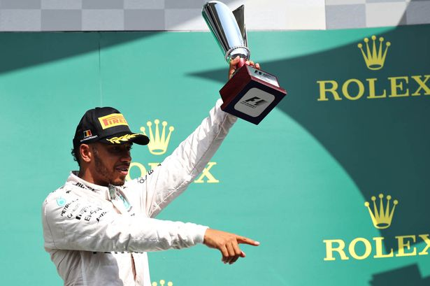 Lewis Hamilton celebrates on a podium