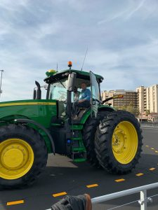 David Cardinal getting a lift in an automated John Deere tractor