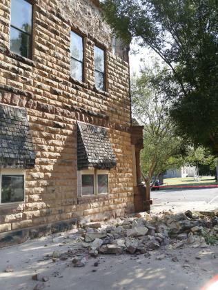 Sandstone bricks from a side of a ancestral Pawnee County Bank spawn a pavement after an early morning trembler in Oklahoma. Picture: Paul Hellstern/The Oklahoman around AP