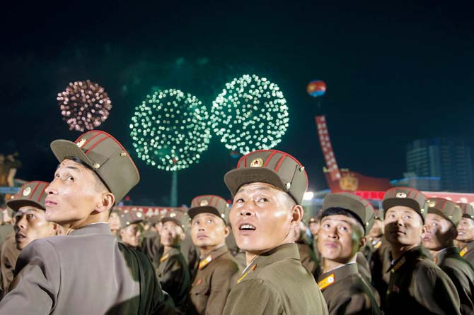 North Korean soldiers at a celebration for the latest n-test. Pic  AFP