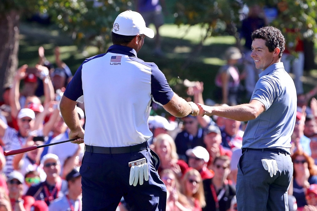 mcilroy-bumped-fists-with-reed-after-he-sank-the-ball-from-20ft-following-mcilroy-s-60ft-putt-on-the-8throb-schumacher-usa-today