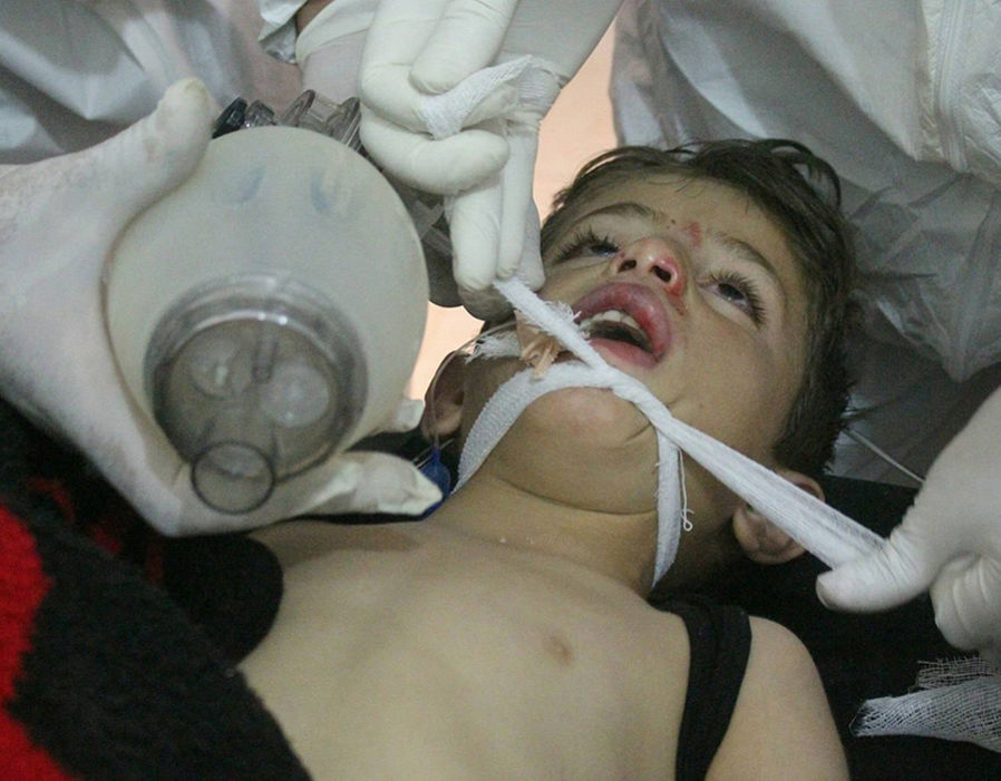 A child receiving treatment at a field hospital after an alleged chemical attack in Idlib northen Syria