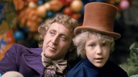 Gene Wilder as Willy Wonka and Peter Ostrum as Charlie Bucket in a film Willy Wonka and a Chocolate Factory