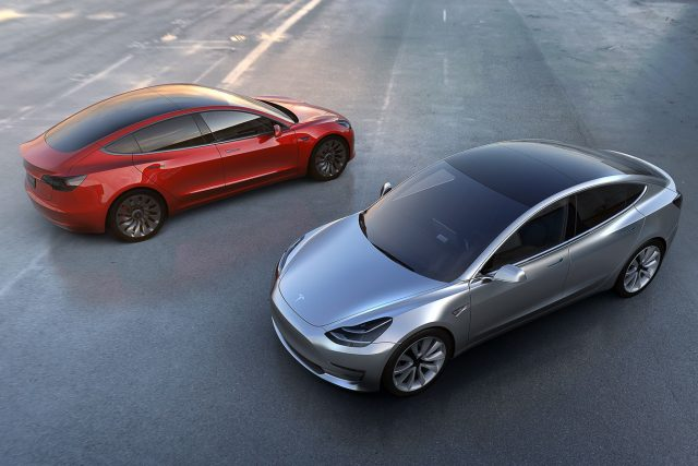 Tesla Model 3 red and blue