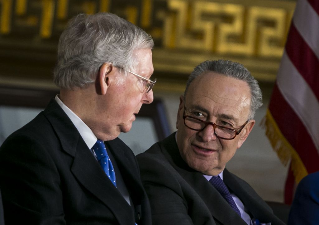 Senate Majority Leader Mitch Mc Connell  and Senate Minority Leader Chuck Schumer talk during the congressional Gold Medal ceremony for former Senate Majority Leader Bob Dole at the U.S. Capitol