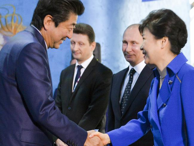 South Korean President Park Geun-hye, right, and Japanese Prime Minister Shinzo Abe consulted any other following news of North Korea's latest chief test.