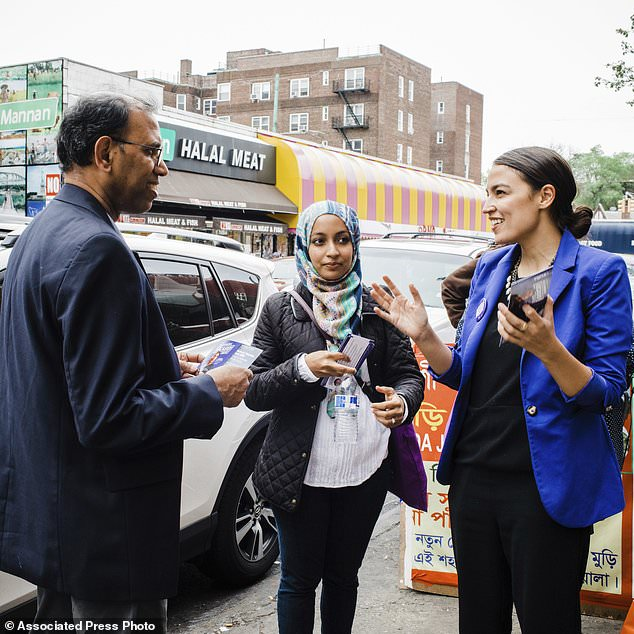 Alexandria Ocasio Cortez Campaign shows candidate Alexandria Ocasio-Cortez right during a Bengali community outreach in New York. Ocasio-Cortez a 28-year-old political novice running on a low budget and an unabash