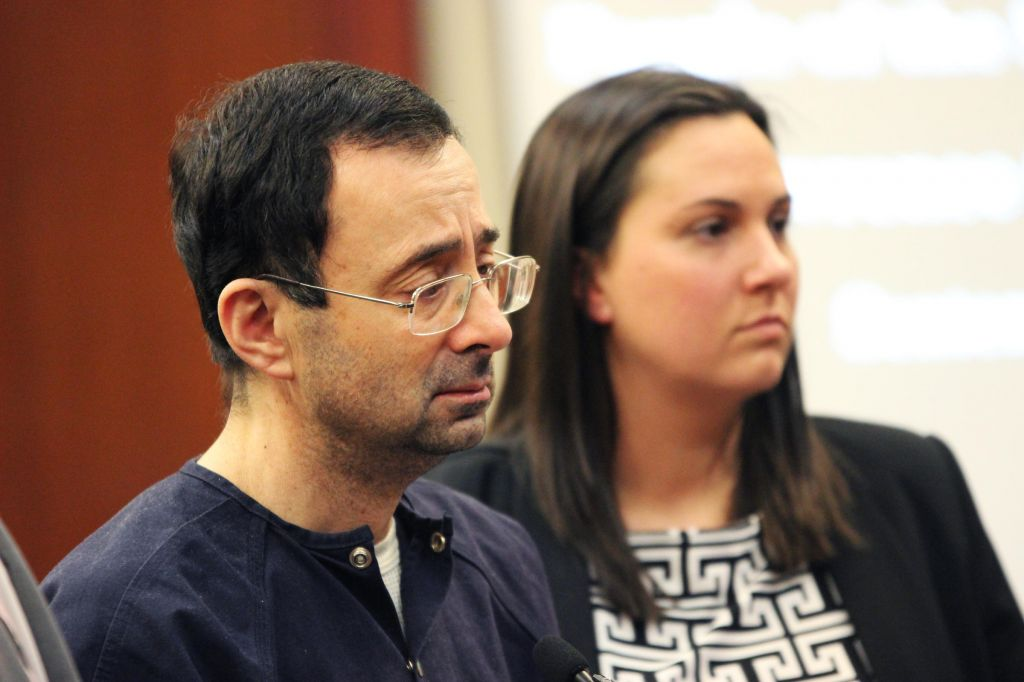 Larry Nassar listens to Ingham County Judge Rosemarie Aquilina hand down his sentence of 175 years in prison