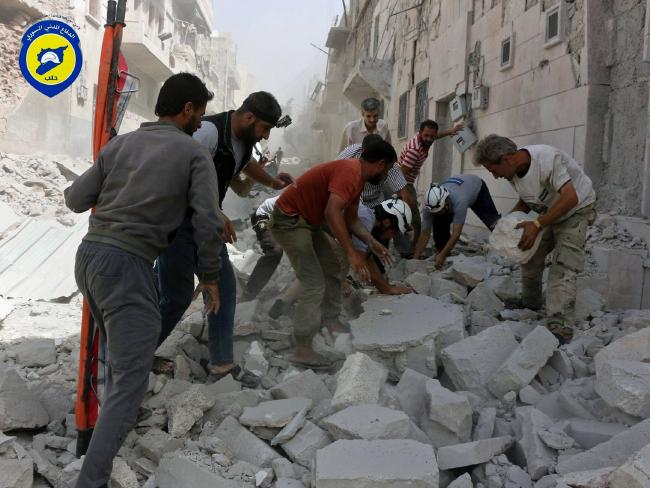 Rescue workers hunt for survivors underneath a rubble following atmosphere strikes in a al-Sakhour community of a rebel-held partial of eastern Aleppo, Syria. Picture: Syrian Civil Defence White Helmets around AP