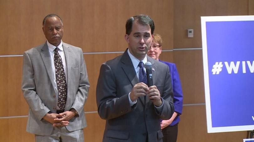 Wisconsin Gov. Scott Walker gives remarks during a stop at Mayo Clinic Health System in Eau Claire on Monday