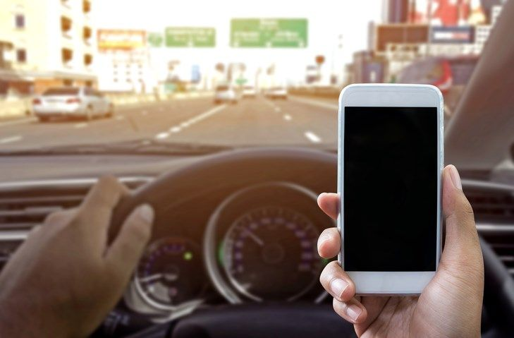 Georgia lawmakers look to ban handheld devices while driving