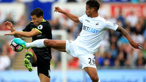 Chelsea's Eden Hazard and Swansea's Kyle Naughton strife during Liberty Stadium on Sunday