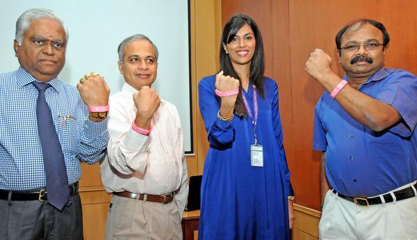 Swathi Rohit, Chief Business Officer SNR Sons Charitable Trust releasing a breast cancer recognition USB wristband during a duty organized by Sri Ramakrishna Institute of Oncology and Research in Coimbatore on Saturday. Director of the