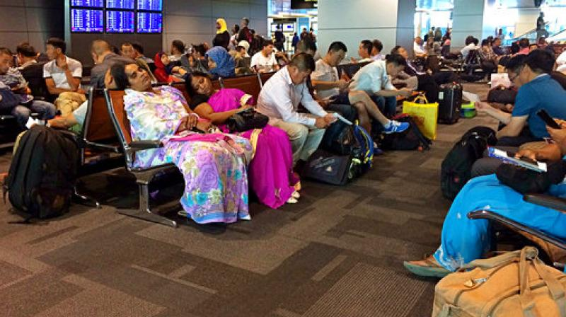 Passengers of cancelled flights wait in Hamad International Airport in Doha Qatar. Qatar's foreign minister says Kuwait is trying to mediate a diplomatic crisis in which Arab countries have cut diplomatic ties and moved to isolate his energy-r