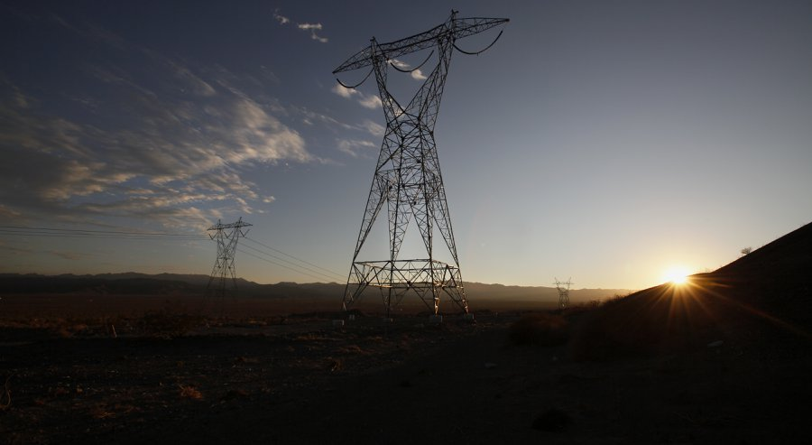 Near Plaster City workers busily construct a transmission tower. A 117-mile electron highway leading into the desert the Sunrise Powerlink means more green energy for San Diego as well as bumper profits for the local utility at a significant price to C