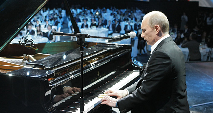 Russian President Vladimir Putin plays the piano at a charity concert for children stricken with cancer and eye diseases held at St. Petersburg's Ice Palace