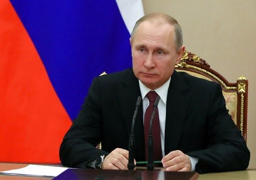 Russian President Vladimir Putin chairs a Security Council meeting in Moscow Russia. The State Department has notified Congress that it will not impose new sanctions on Russia at this time. The State Department says it is