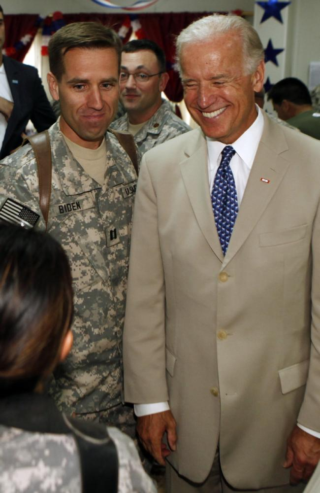 US clamp boss Joe Biden with his late son, US Army Captain Beau Biden. Picture: AP / Khalid Mohammed