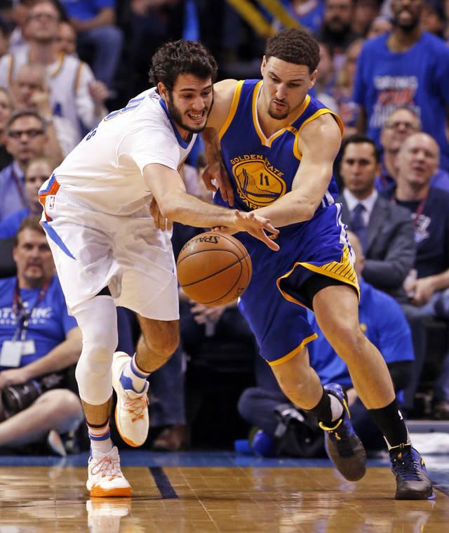 Oklahoma City's Alex Abrines steals the ball from Warriors#039 Klay Thompson in Monday night's game at the Chesapeake Energy Arena. The Warriors won 111-95