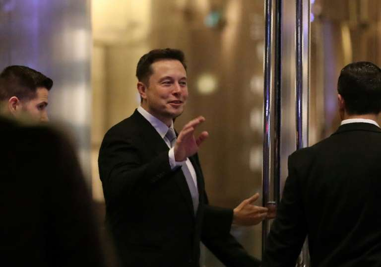 Elon Musk founder and chief executive of electric carmaker Tesla seen at a ceremony in Dubai in February said he would quite President Donald Trump's advisory panels if Washington pulls out of the Paris global climate agreement