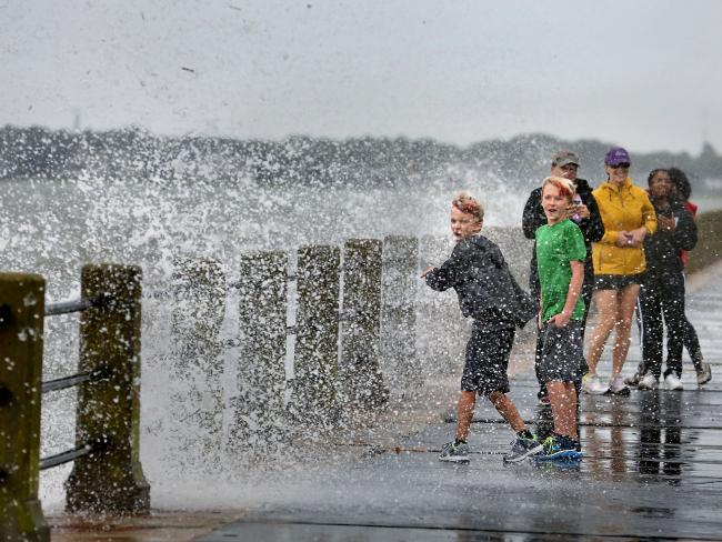 Brothers Trey Bowers, 10 and Tyler Bowers, 12, are splashed with salt H2O from a crashing call from Tropical Storm Hermine in Charleston, South Carolina. Picture: AP