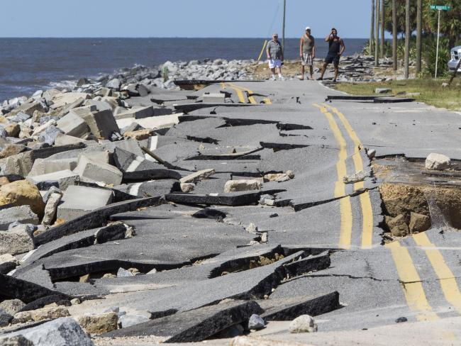 Residents demeanour during Alligator Point highway that collapsed during a charge swell from Hurricane Hermine during Alligator Point, Florida. Picture: AFP
