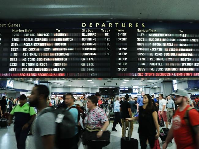 Large crowds rush to skip New York's Pennsylvania hire before a start of a Labour Day holiday weekend. Picture: AFP