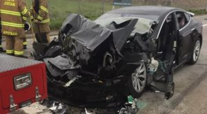Tesla after crashing into a parked fire truck