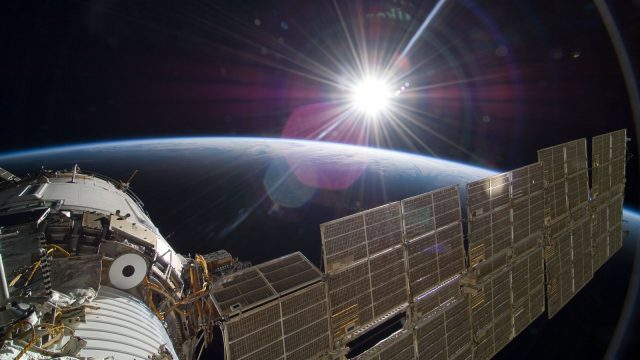 Sun rises over Earth, taken from the International Space Station