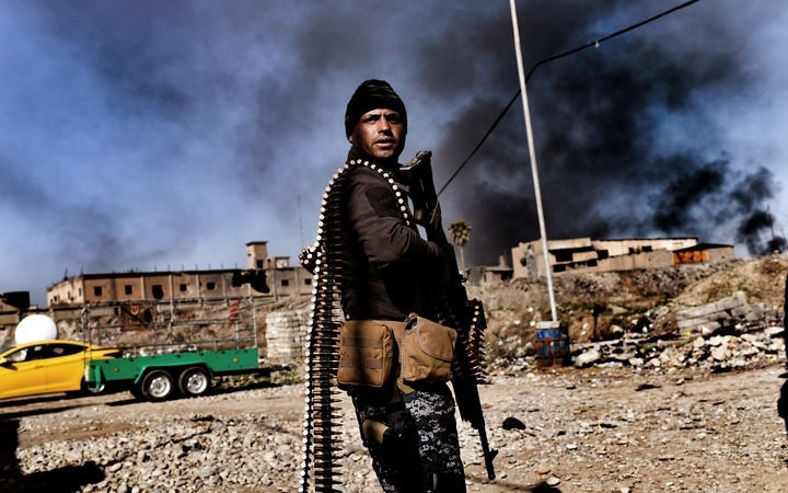 A member of Iraq's elite Rapid Response Division holds position in the northern city of Mosul as they continue the offensive to retake the city's western half from Islamic State