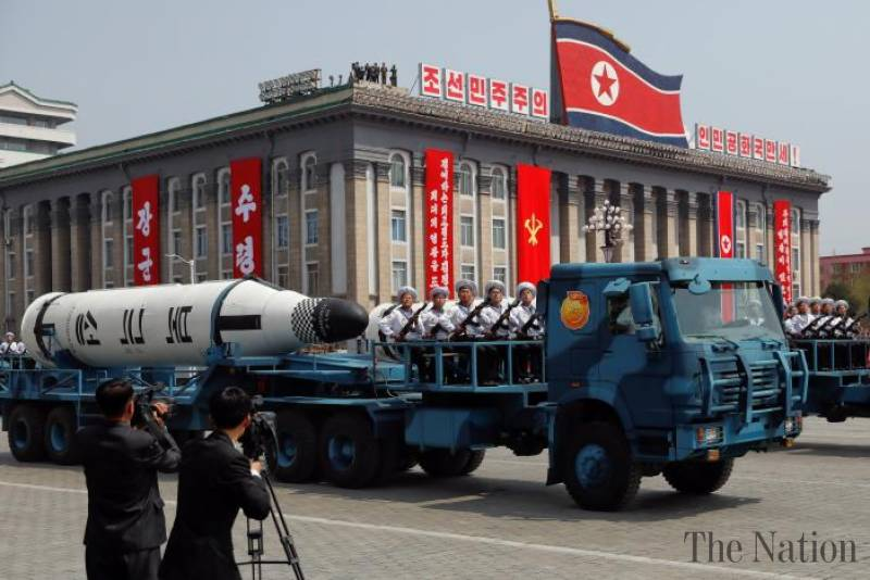 North Korea displays apparently new missiles as US carrier group approaches