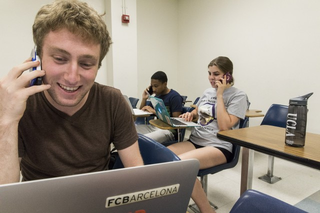 Cameron Keller a first-year political science student Matt Dunham a second-year political science student and Erica Griggs a first-year English student call Montanans and urge them to vote Rob Quist for Congress