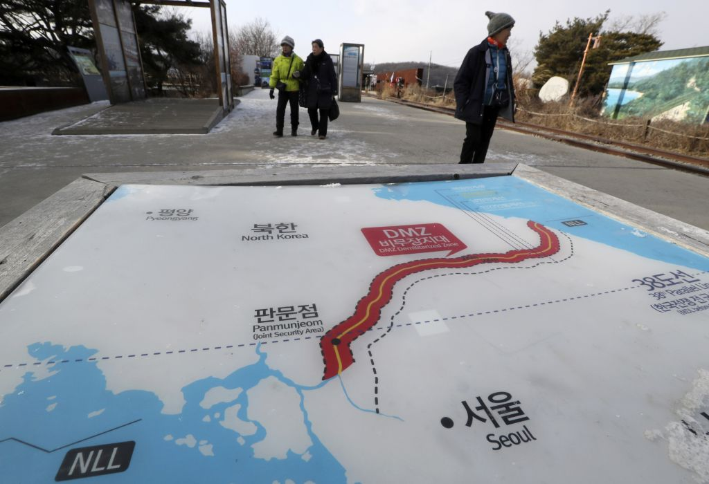 Visitors walk by a map of North and South Korea at the Imjingak Pavilion in Paju South Korea on Jan. 9. North Korea agreed Tuesday to send a delegation to next month's Winter Olympics in South Korea Seoul officials said as the bitter rivals sat for