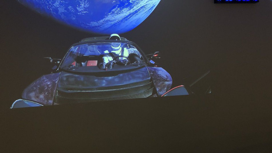 The Tesla Roadster orbits Earth before blasting off further into space