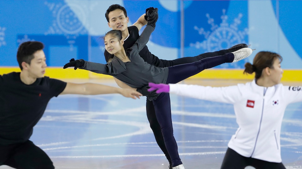 North and South Korean pairs teams practice