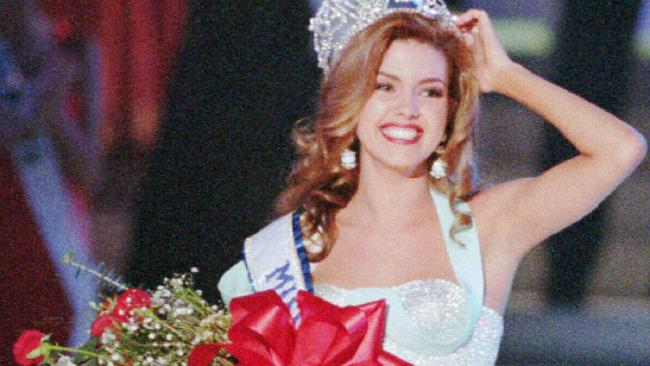 Ms Machado claiming her Miss Universe crown.