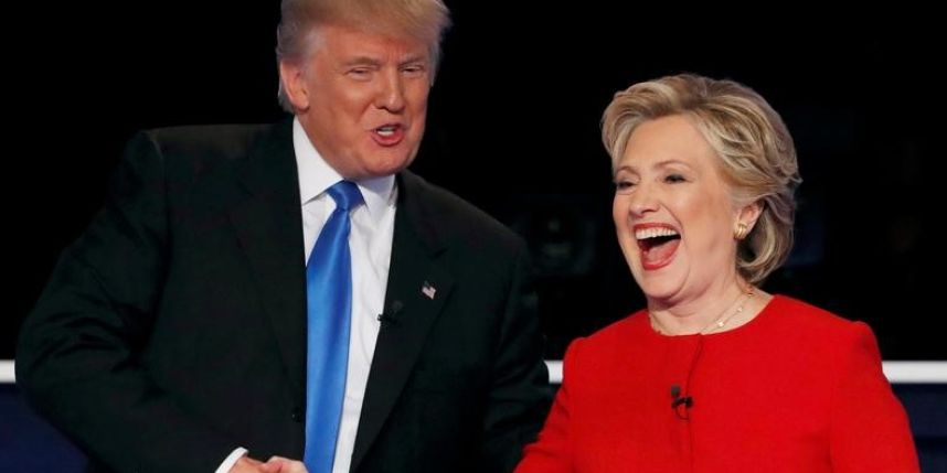 Presidential candidates Donald Trump and Hillary Clinton shake hands after their first debate in October 2016