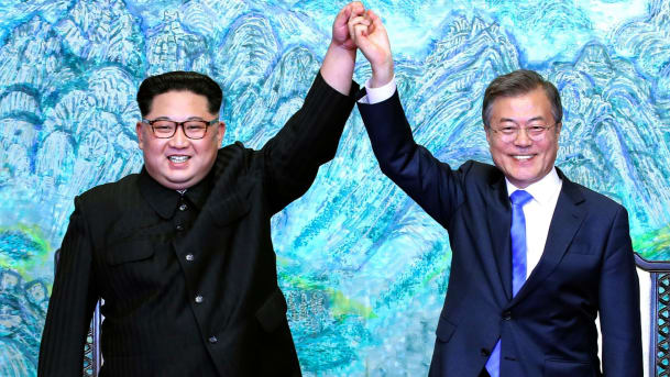 North Korean leader Kim Jong Un left and South Korean President Moon Jae-in raise their hands after signing a joint statement at the border village of Panmunjom in the Demilitarized Zone