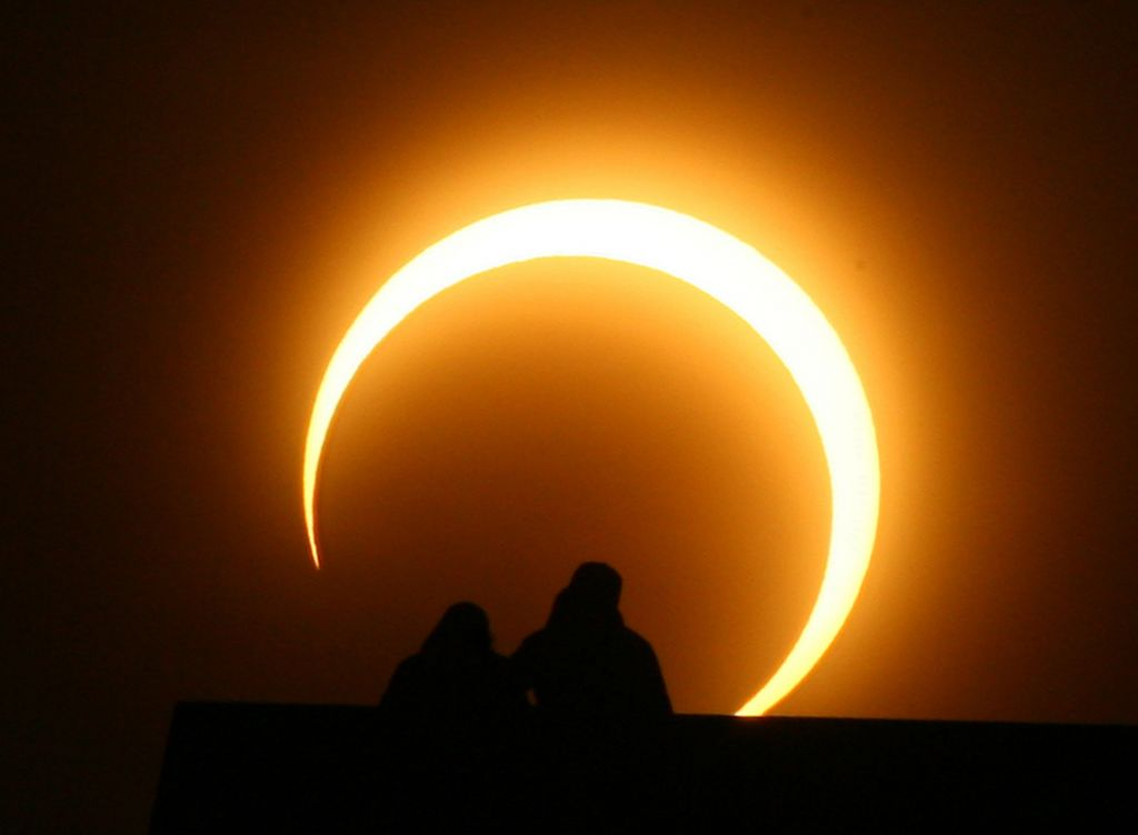 A Chinese couple watches a solar eclipse over Zhengzhou on Jan. 15 2010