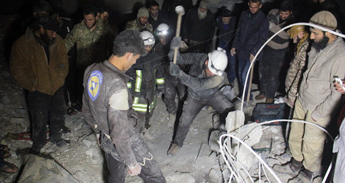 Syrian civil defence volunteers known as the White Helmets dig through the rubble of a mosque following a reported airstrike on a mosque in the village of Al Jineh in Aleppo province late