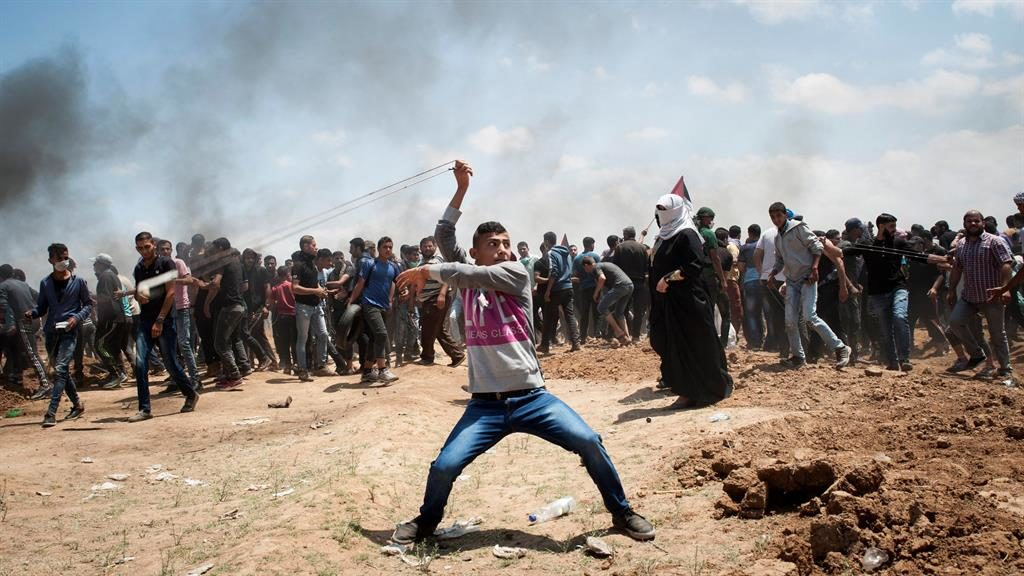 Anger A Palestinian uses a slingshot to hurl a stone during the protests