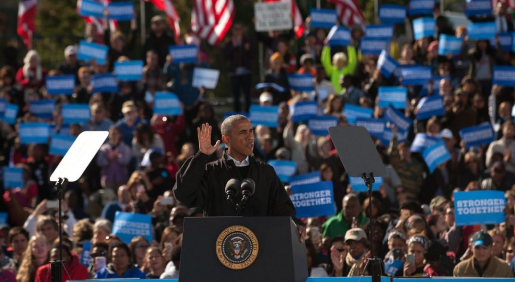 President Barack Obama campaigns for Hillary Clinton at a'Get Out the Early Vote rally at Cleveland Burke Lakefront Airport on Friday