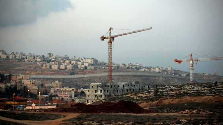 Israel's controversial wall separating the Jewish settlement of Neve Yaakov in the northern area of east Jerusalem and the Palestinian neighborhood of al Ram in the West Bank