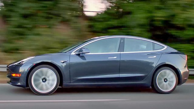 Tesla model 3 blue left profile