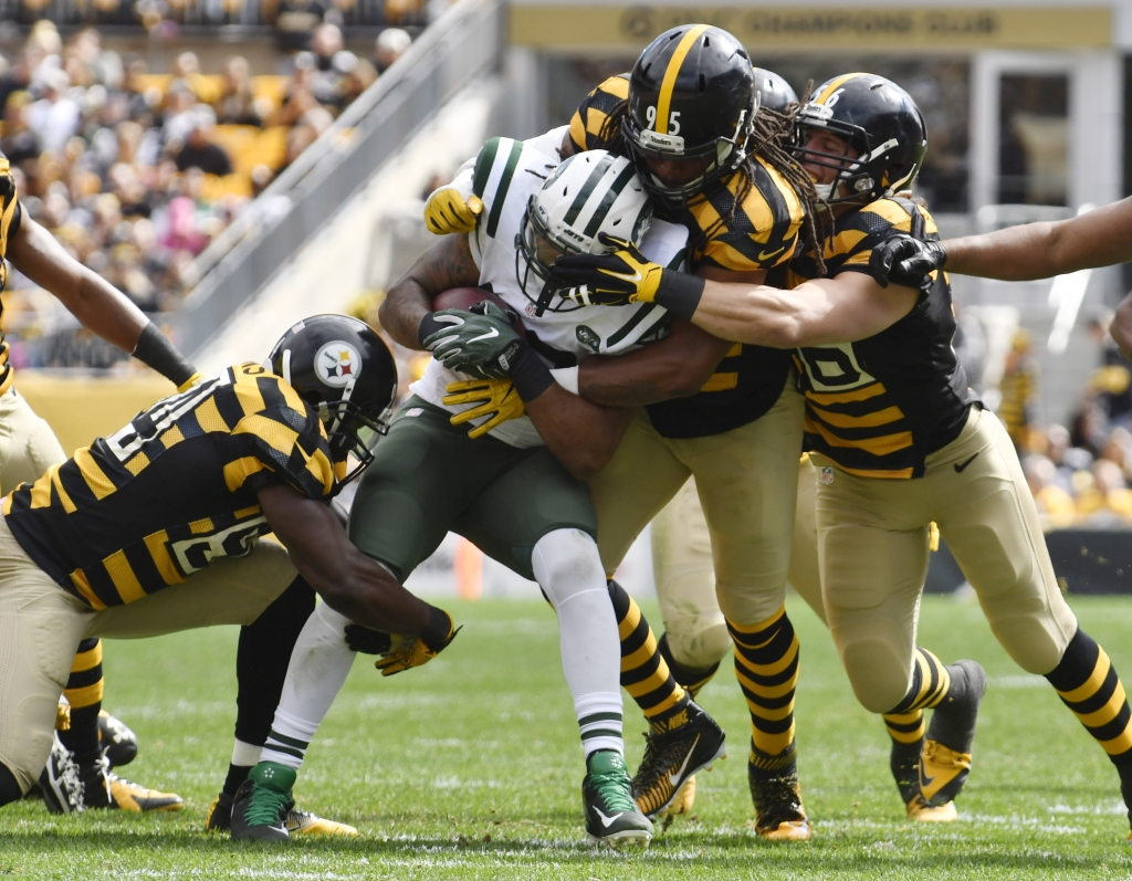 Oct 9 2016 Pittsburgh PA USA Pittsburgh Steelers outward linebacker Jarvis Jones and other defenders make a tackle on New York Jets using behind Matt Forte during a initial entertain during Heinz Field opposite a New York Jets. Mandatory Credit