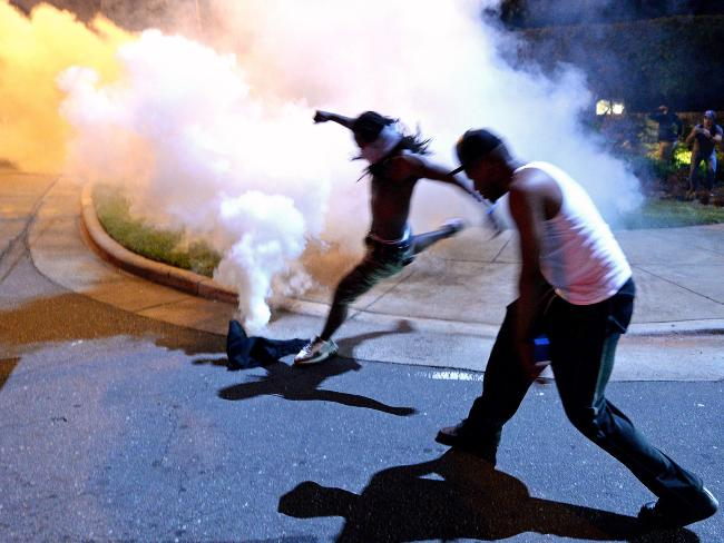 Authorities used rip gas to sunder protesters in an overnight proof that pennyless out Tuesday after Keith Lamont Scott was fatally shot by an officer during an unit complex. Picture: Jeff Siner/The Charlotte Observer around AP
